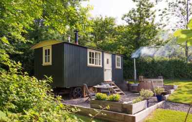 exterior-view-of-meadow-hut-with-hot-tub-and-seating-area-in-lombard-farm-glamping-with-hot-tub-cornwall