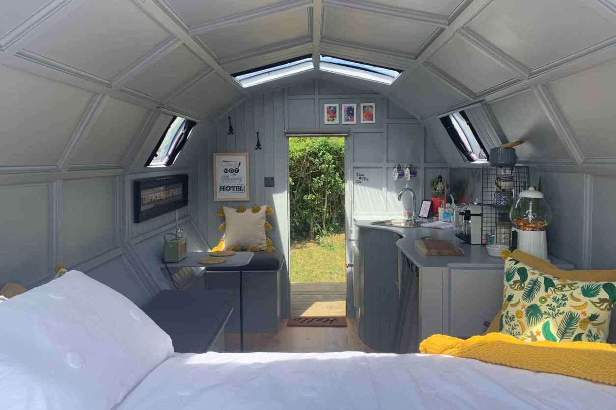 interior-of-wilderness-wagon-with-bed-and-kitchen