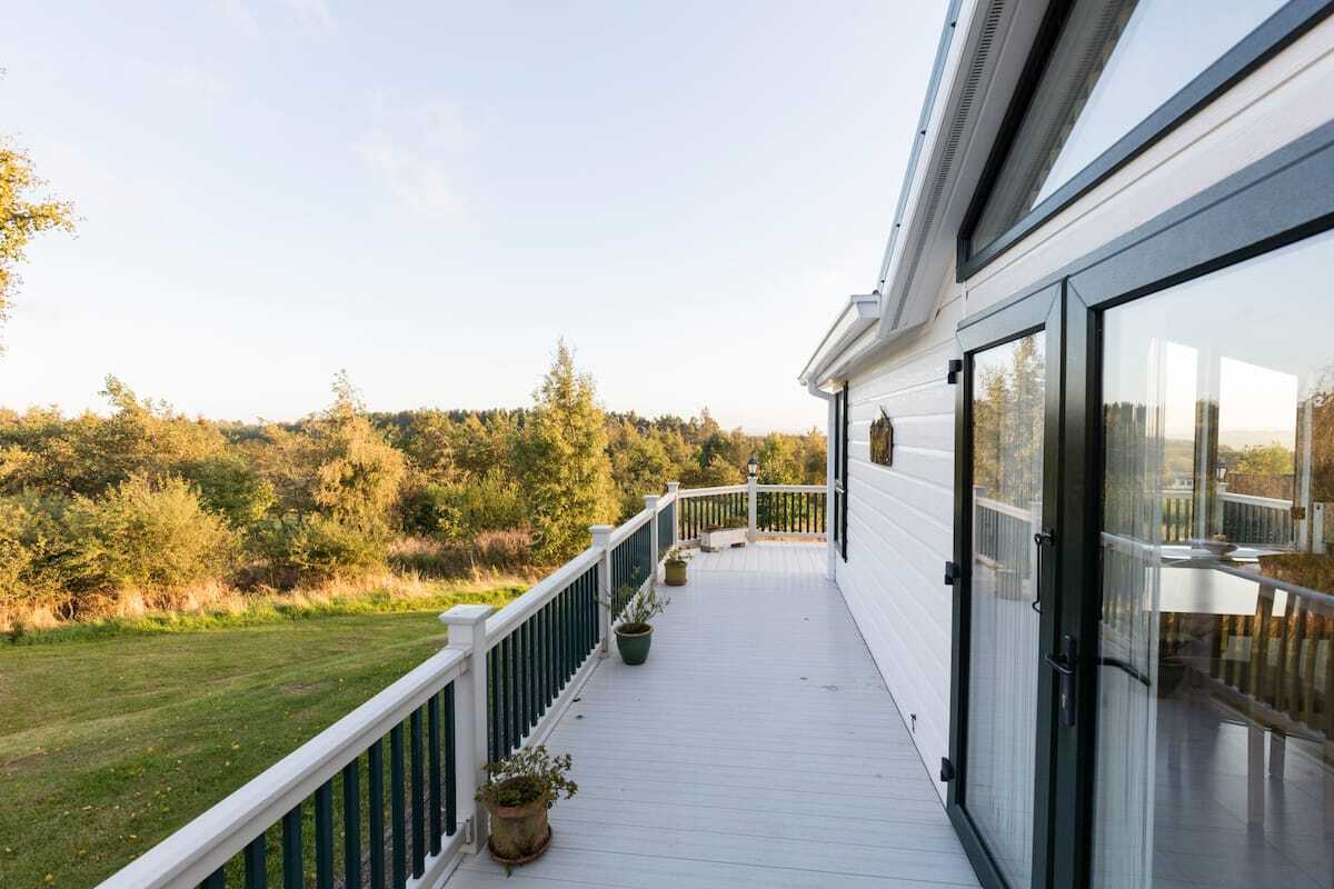 large-decking-of-whin-fell-lodge-overlooking-fields-lodges-with-hot-tubs-northumberland