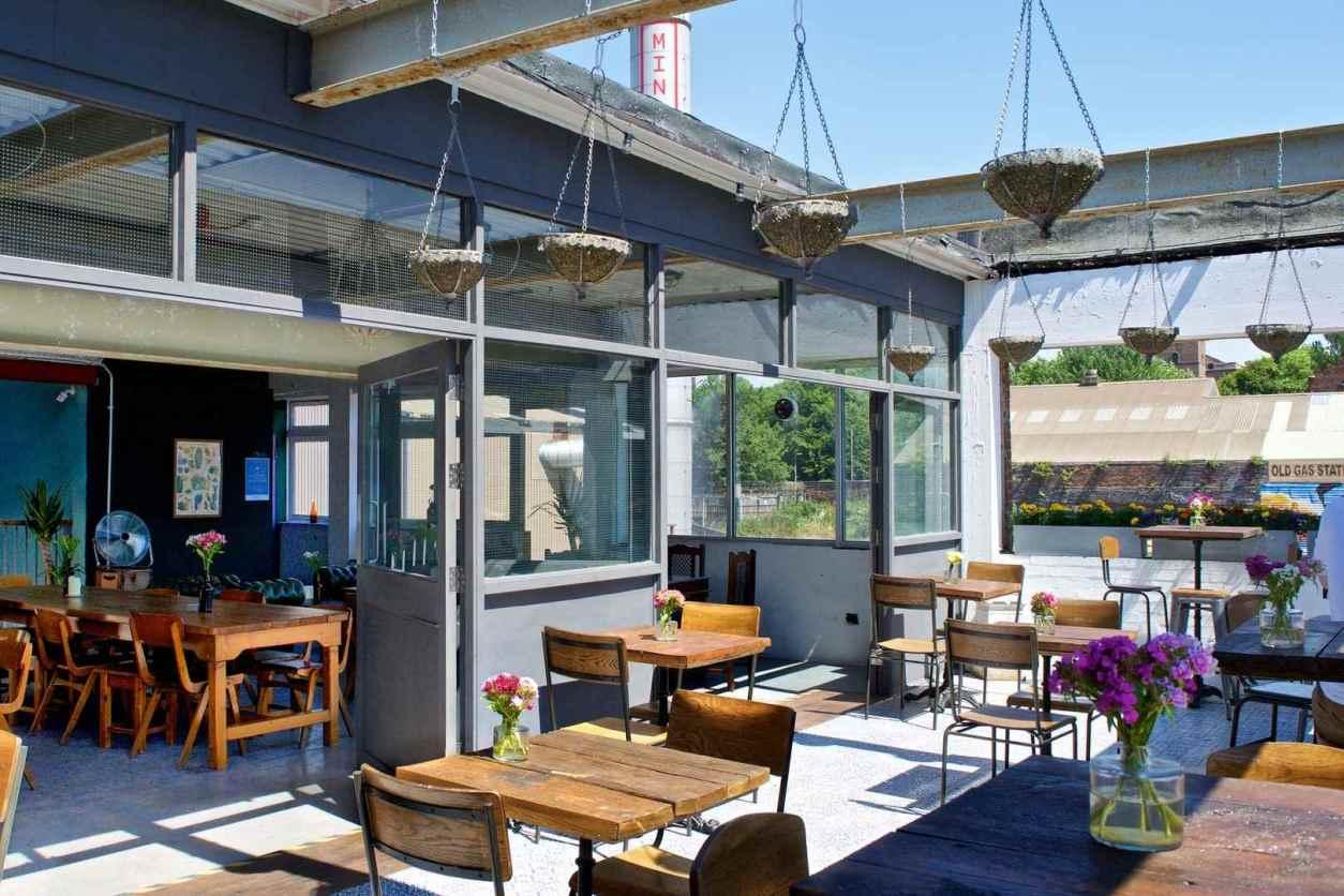 outdoor-dining-area-at-dockleaf-bar-best-cocktail-bars-liverpool