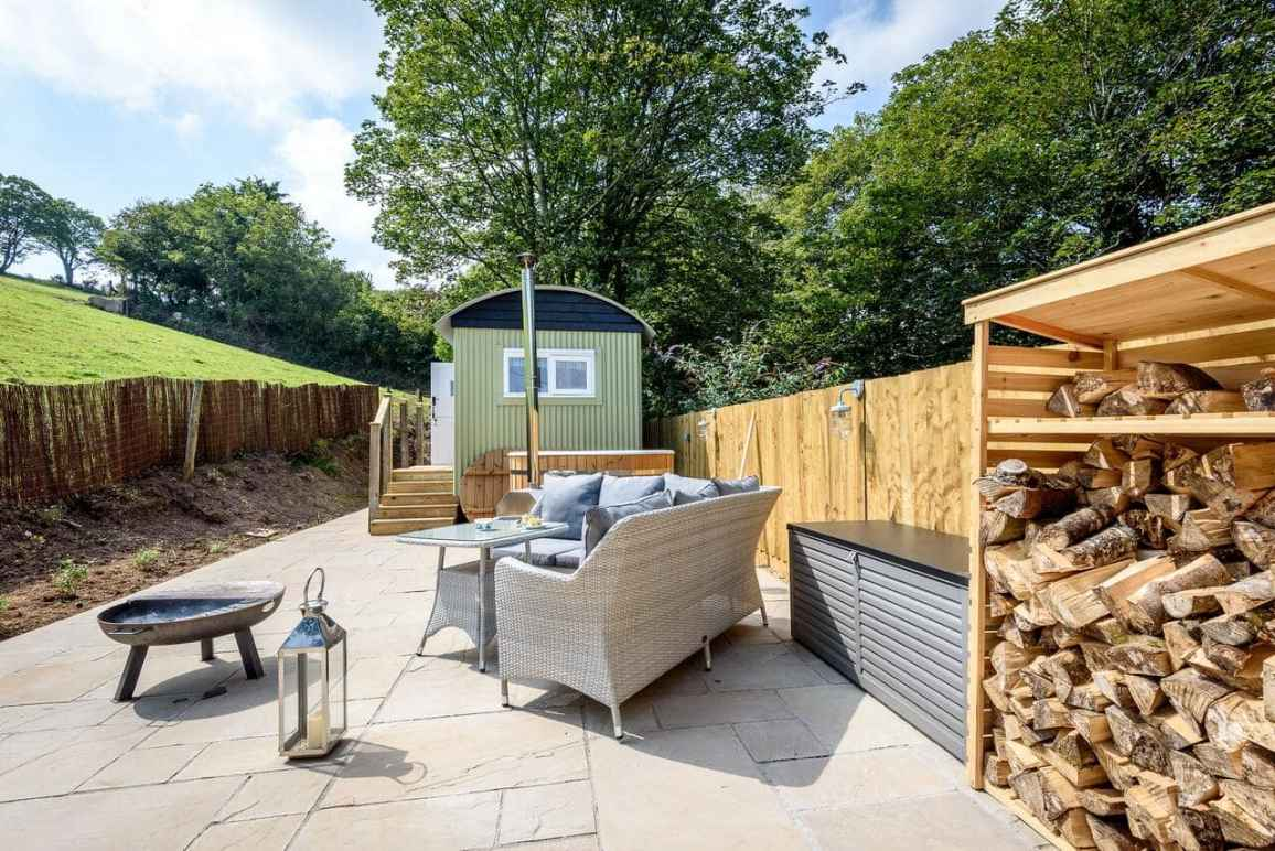 outdoor-seating-area-and-fire-pit-by-green-shepherds-hut-glamping-with-hot-tub-cornwall