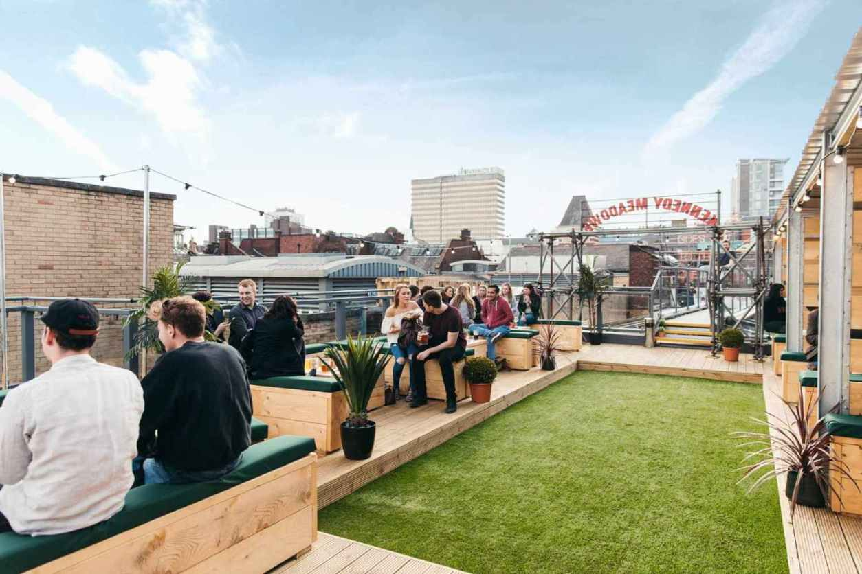 people-drinking-at-headrow-house-rooftop-bars-leeds