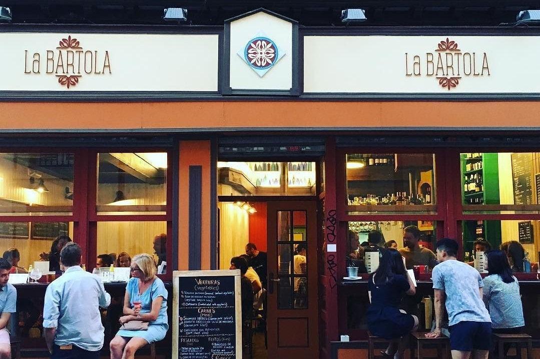 people-sitting-outside-la-bartola-restaurant
