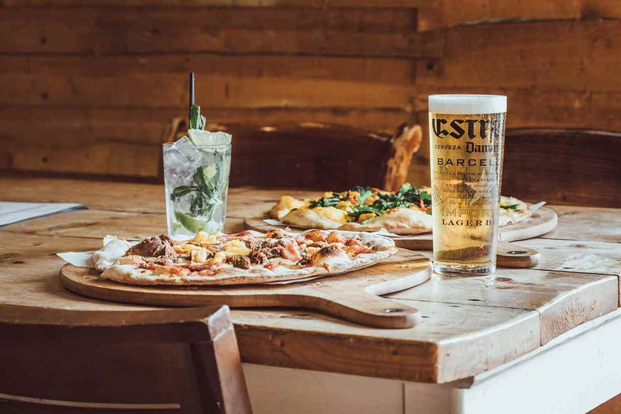 pizza-beer-and-cocktails-on-table-at-craft-and-dough-bottomless-brunch-sheffield