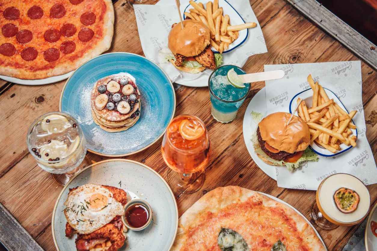 pizza-burgers-pancakes-and-cocktails-on-revolution-restaurant-table-bottomless-brunch-derby