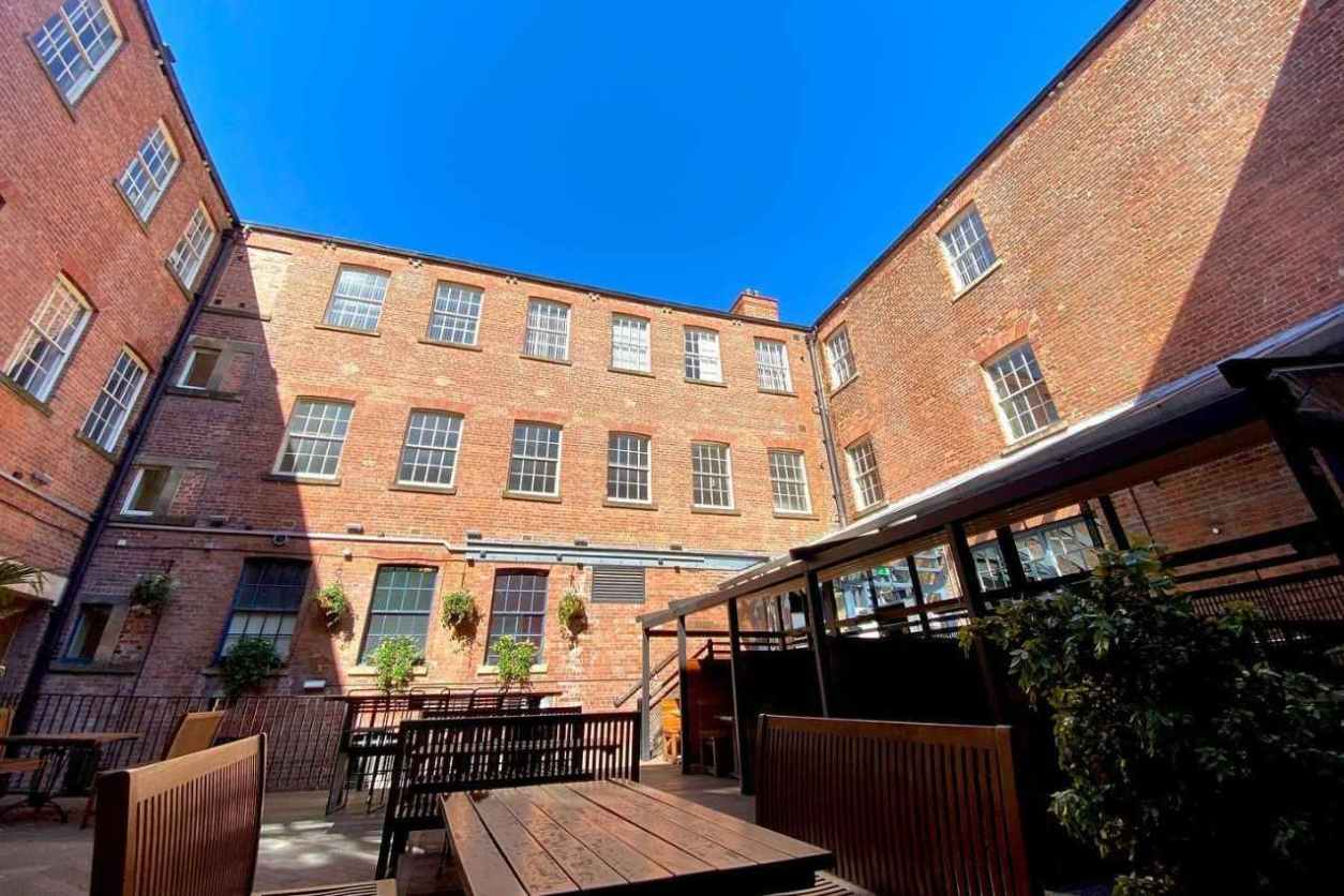 pub-courtyard-on-sunny-day-at-a-nation-of-shopkeepers