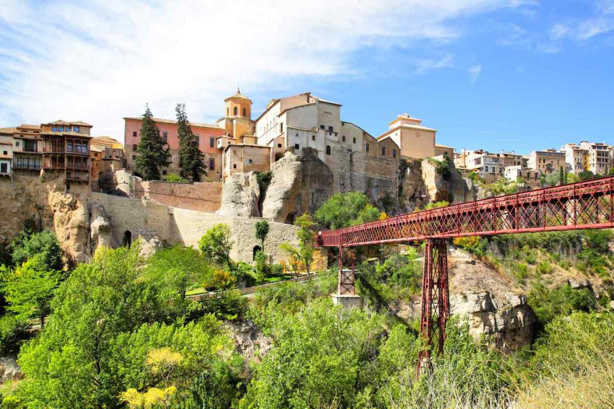 red-bridge-leading-to-town-in-hills-on-sunny-day-in-cuenca-day-trips-from-valencia