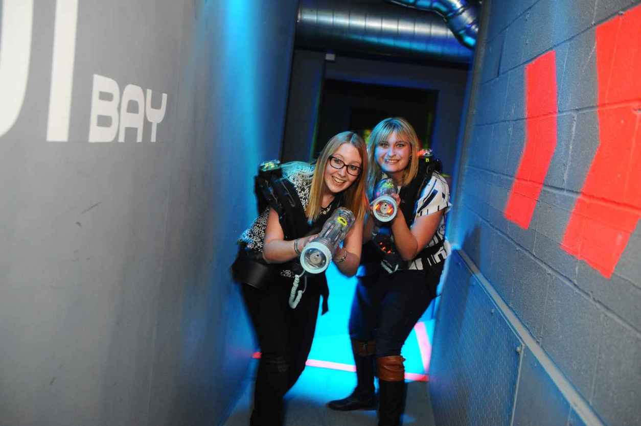 two-blonde-women-with-lasers-at-superbowl-indoor-activities-cardiff