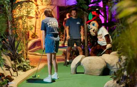 young-couple-playing-crazy-golf-at-treetop-adventure-golf-indoor-activities-cardiff