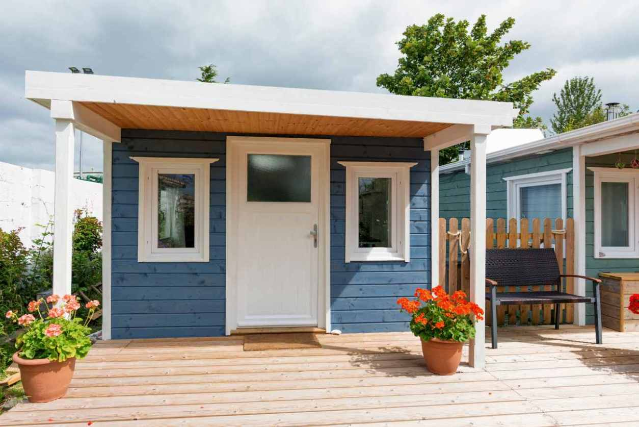 blue-off-grid-cabin-on-sheltered-decking-glamping-galway