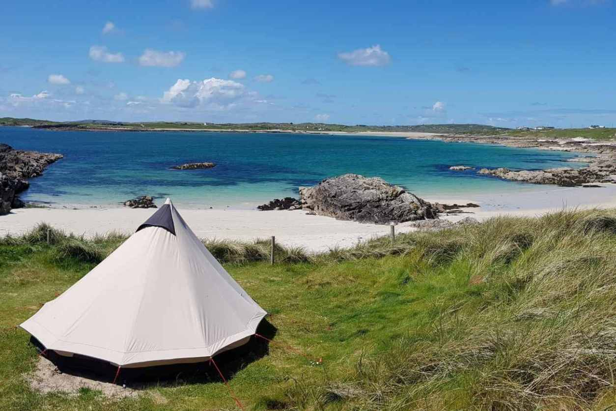 clifden-eco-beach-camping-tipi-on-grass-by-sea-glamping-galway