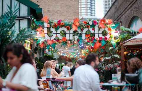 people-eating-and-drinking-outdoors-at-barrio