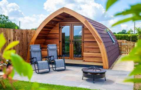 sunloungers-in-front-of-swallows-field-glamping-pod-glamping-essex