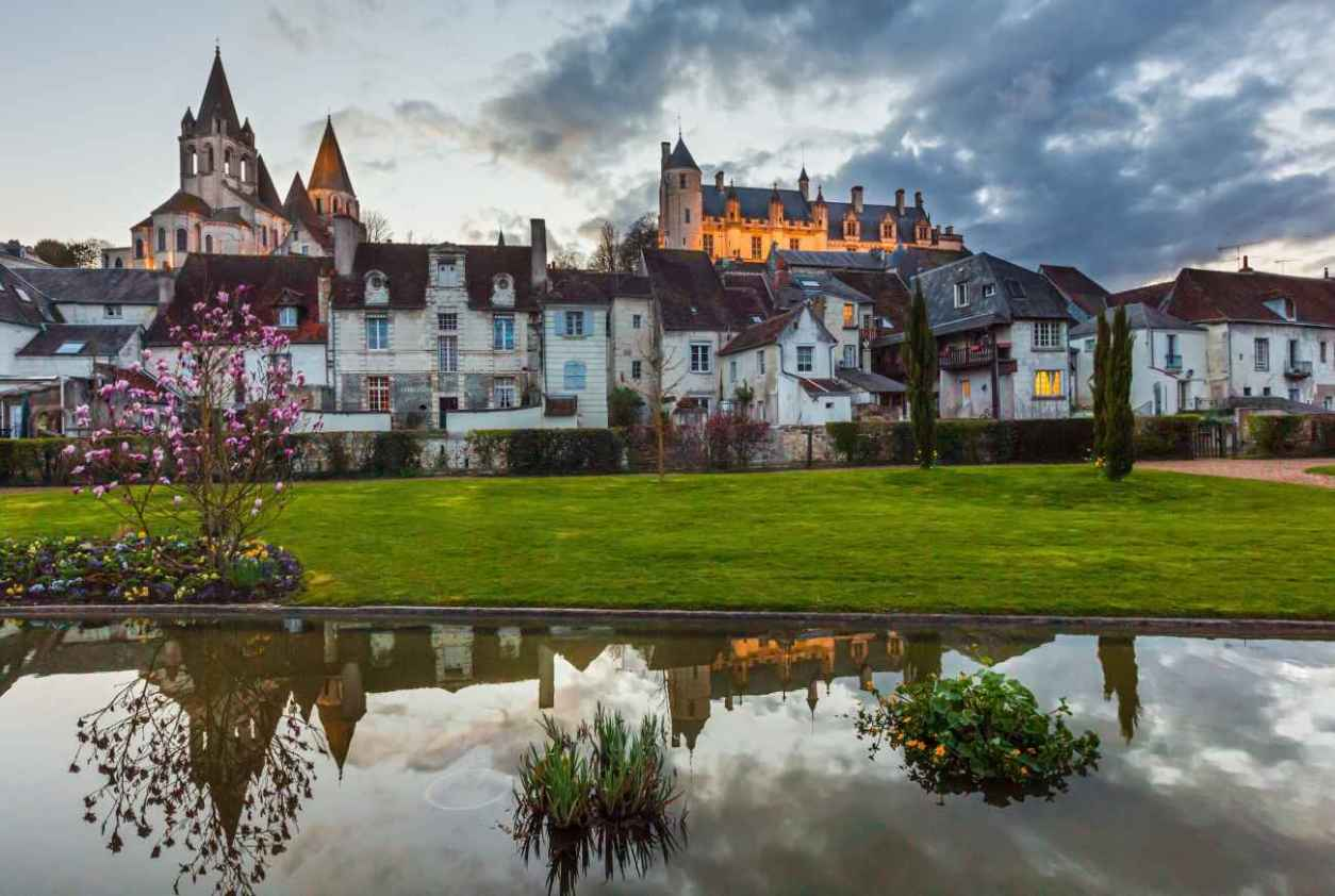 view-of-château-de-loches-over-houses-at-sunset