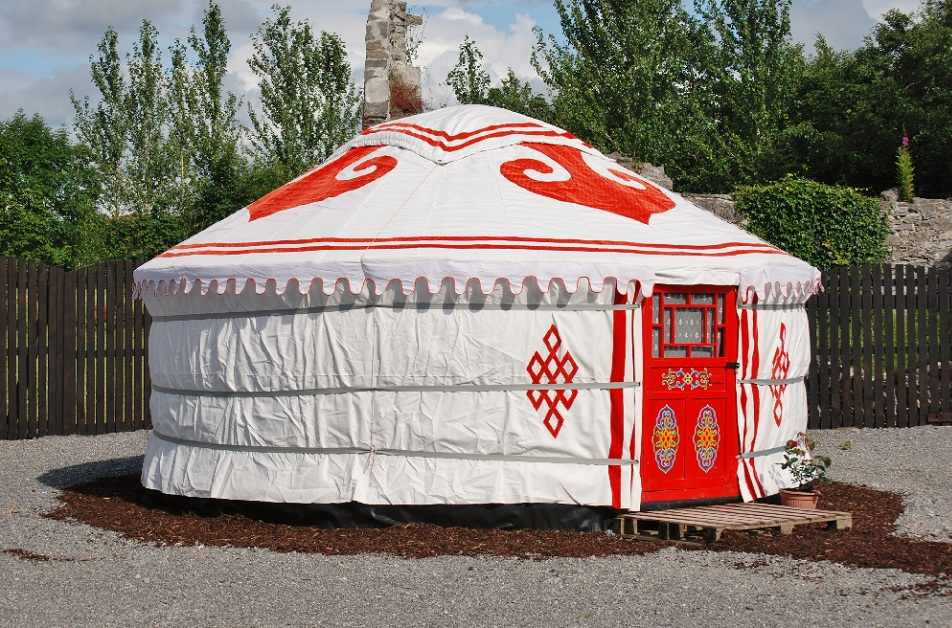 white-and-red-whispering-willow-yurt-on-raised-decking