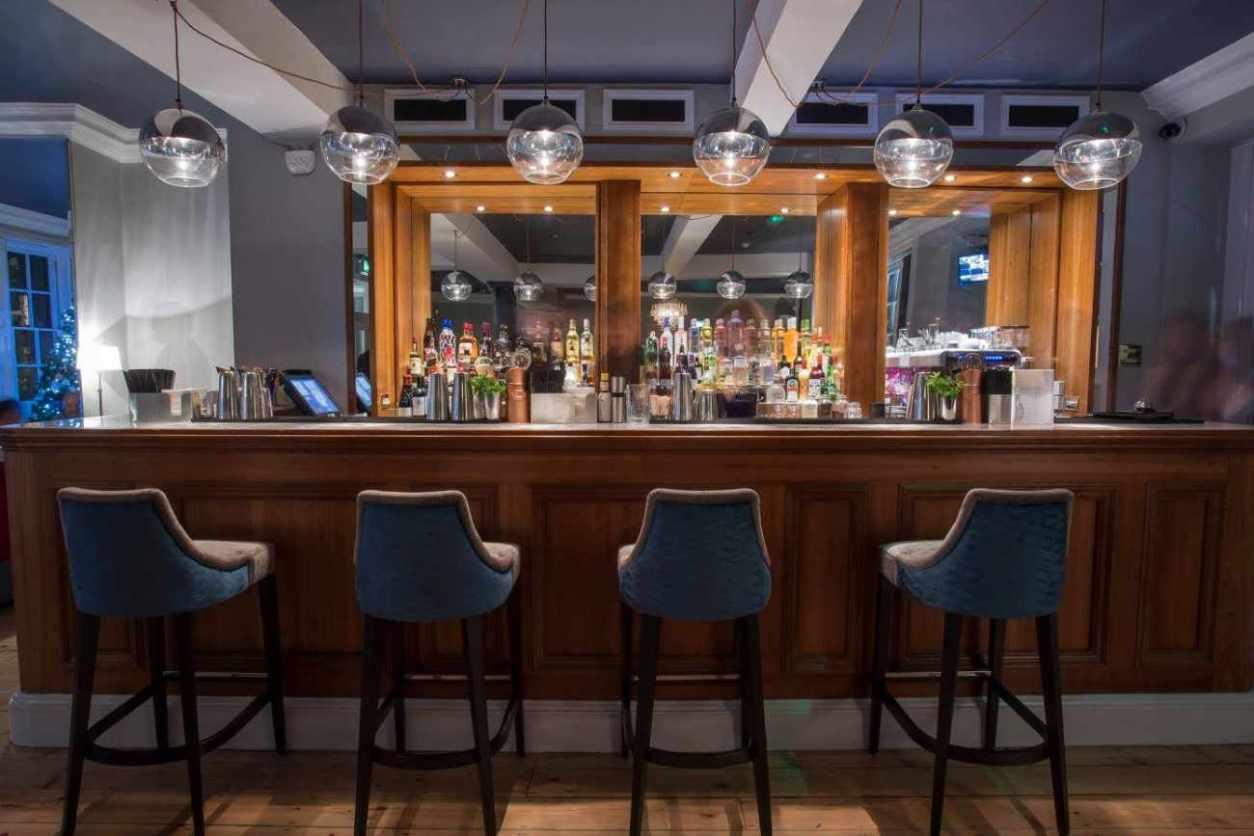bar-stools-at-bar-of-bond-no-28-tombland