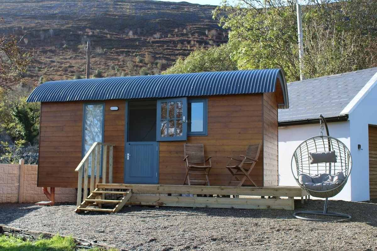 brown-and-blue-atlantic-haven-shepherds-hut-with-outdoor-seating