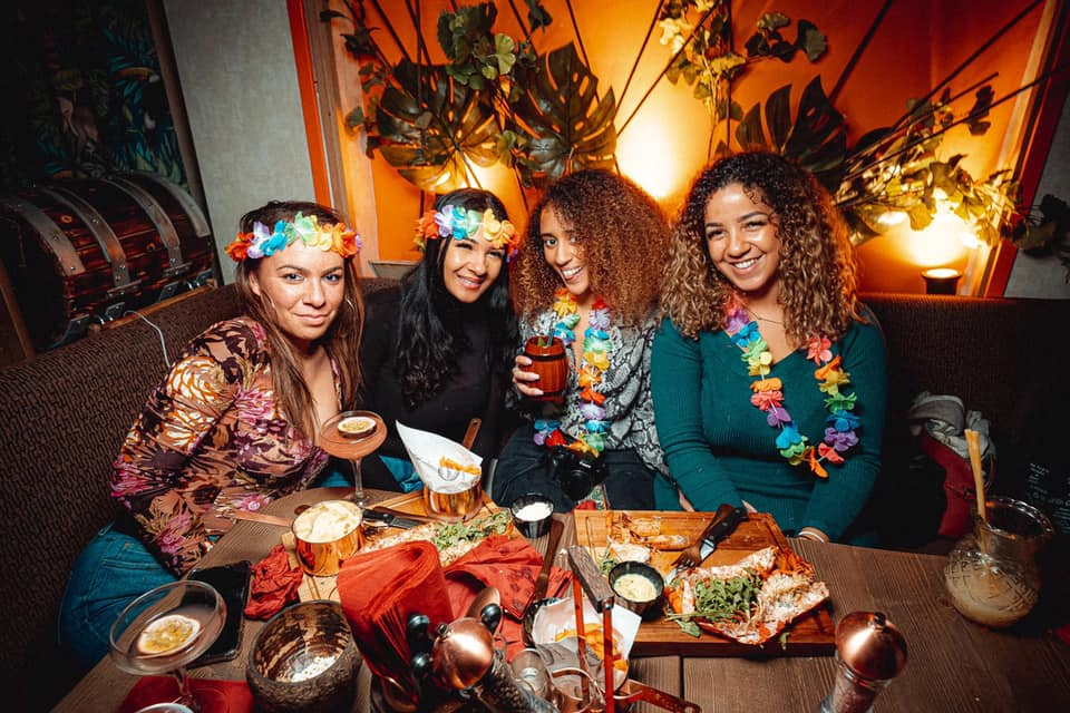 group-of-women-eating-and-drinking-at-tropix-bar-bottomless-brunch-clapham
