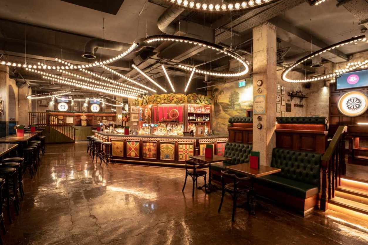 interior-of-flight-club-with-bar-and-restaurant-tables-bottomless-brunch-manchester