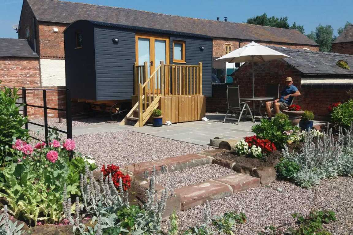 navy-newton-hall-shepherds-hut-with-outdoor-seating