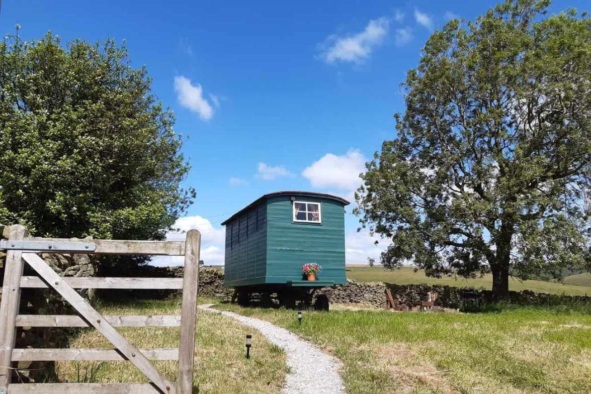 peak-glamping-hideaway-shepherds-hut-at-top-of-field