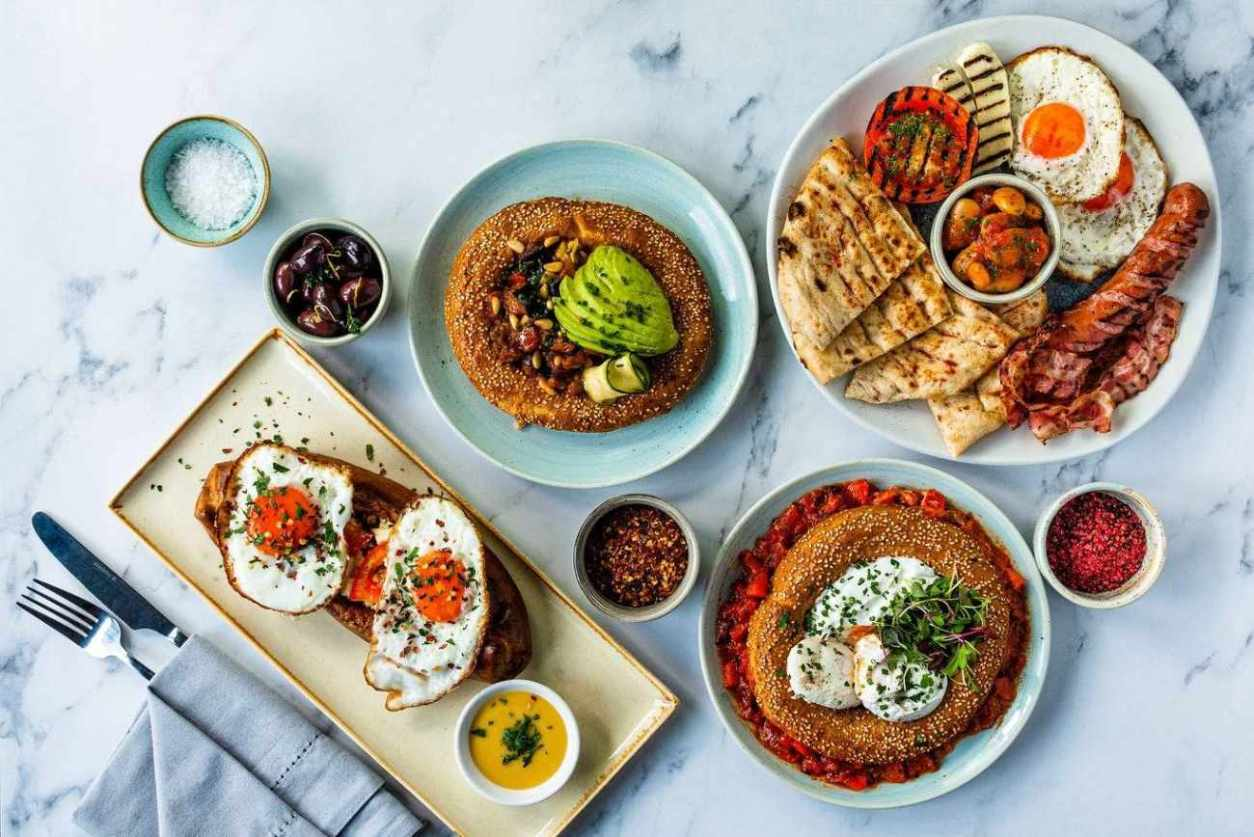 plates-of-greek-food-on-table-of-neos-restaurant-bottomless-brunch-clapham