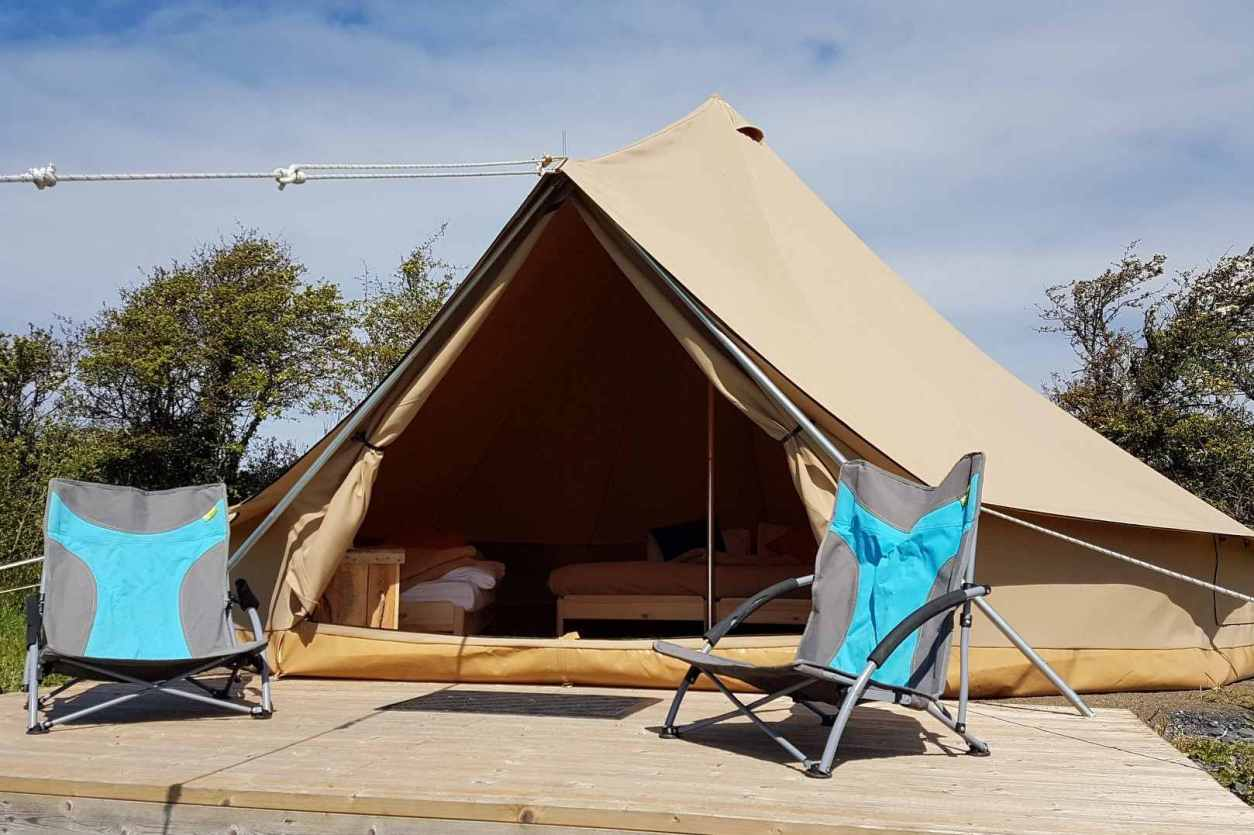 pure-camping-bell-tent-with-camping-chairs-on-decking