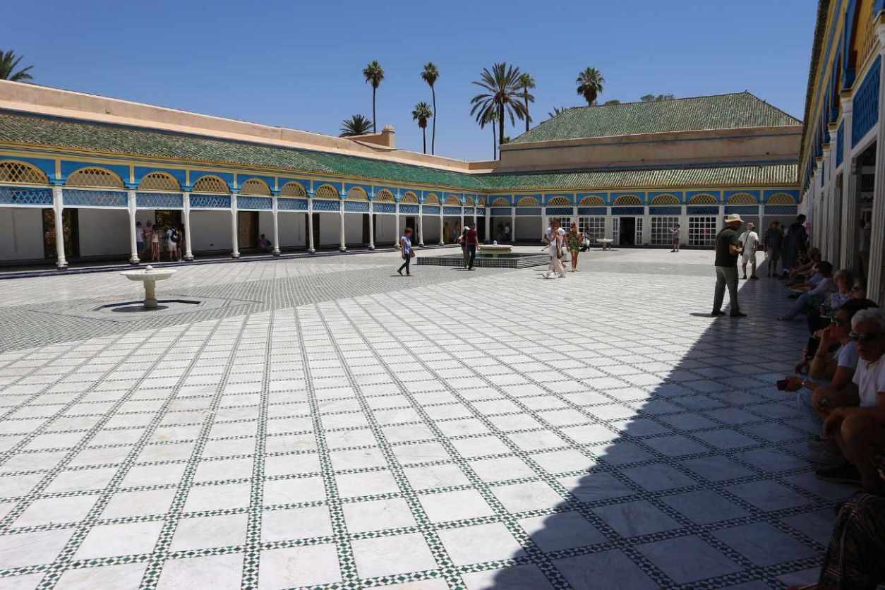 tourists-walking-around-bahia-palace-on-sunny-day
