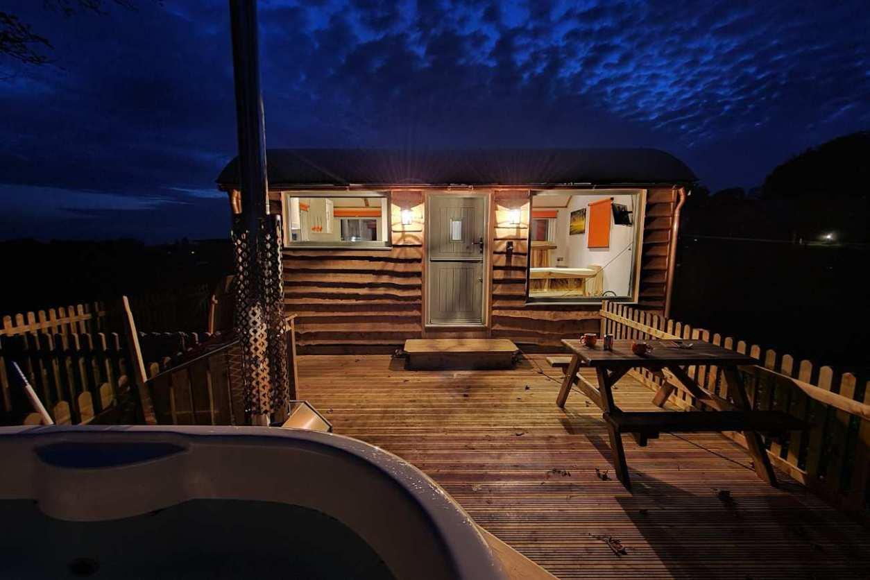 welltrough-hall-farm-shepherds-hut-lit-up-at-night