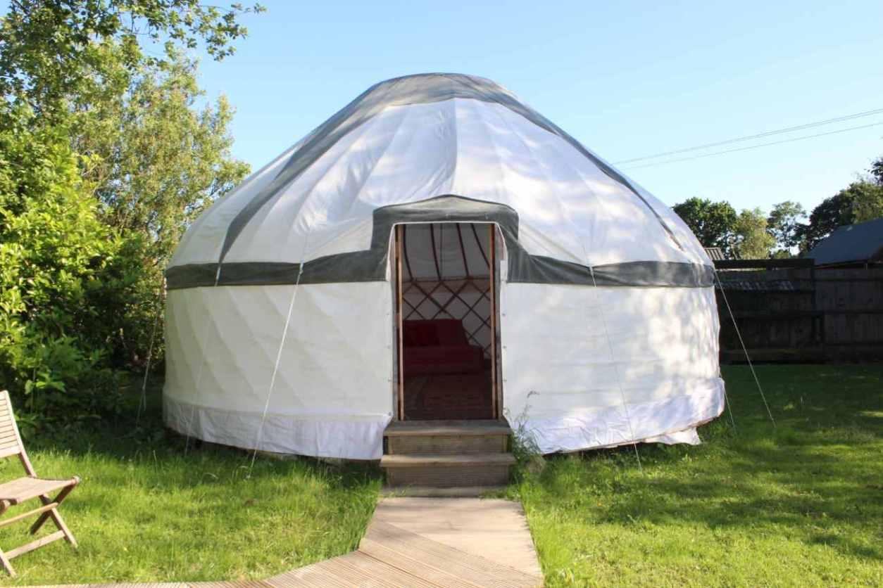 exterior-of-white-bloomsburys-biddenden-yurt-in-grass
