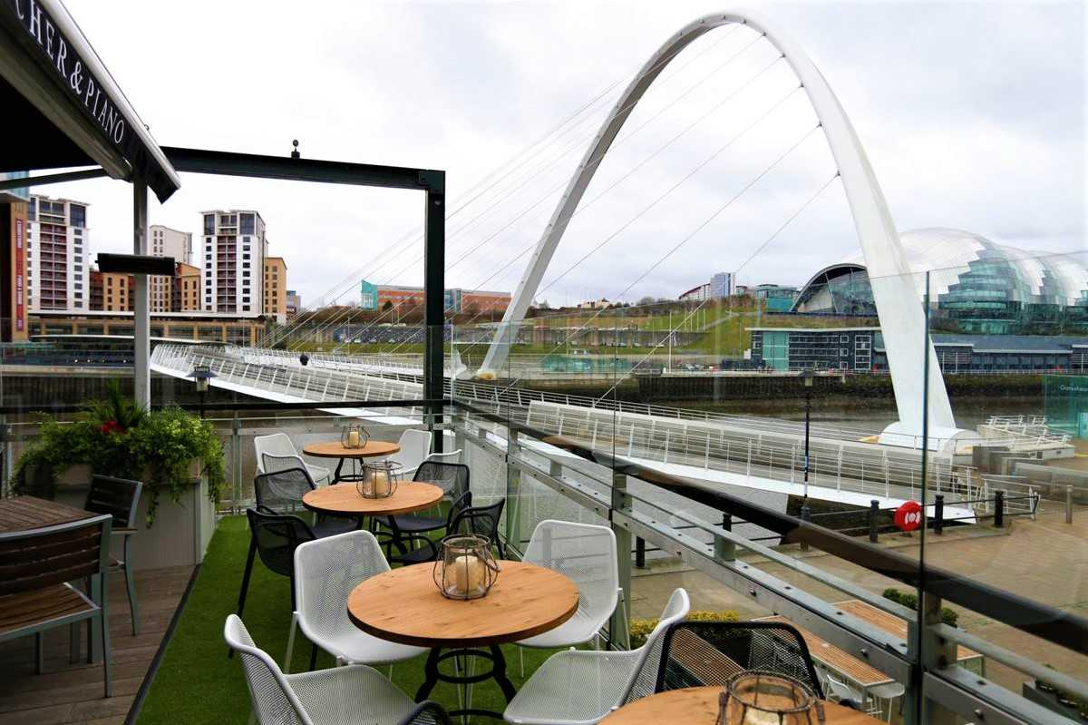pitcher-and-piano-roof-terrace-overlooking-river-and-bridge