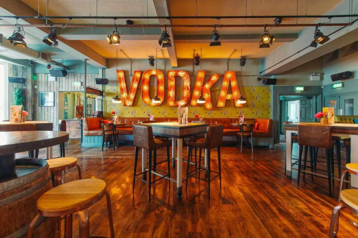 restaurant-tables-inside-revolution-bar-bottomless-brunch-brighton