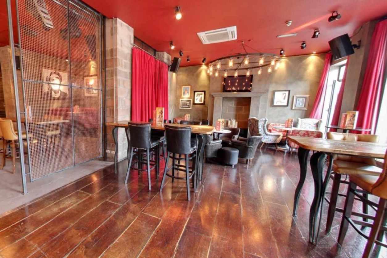 tables-inside-revolution-bar