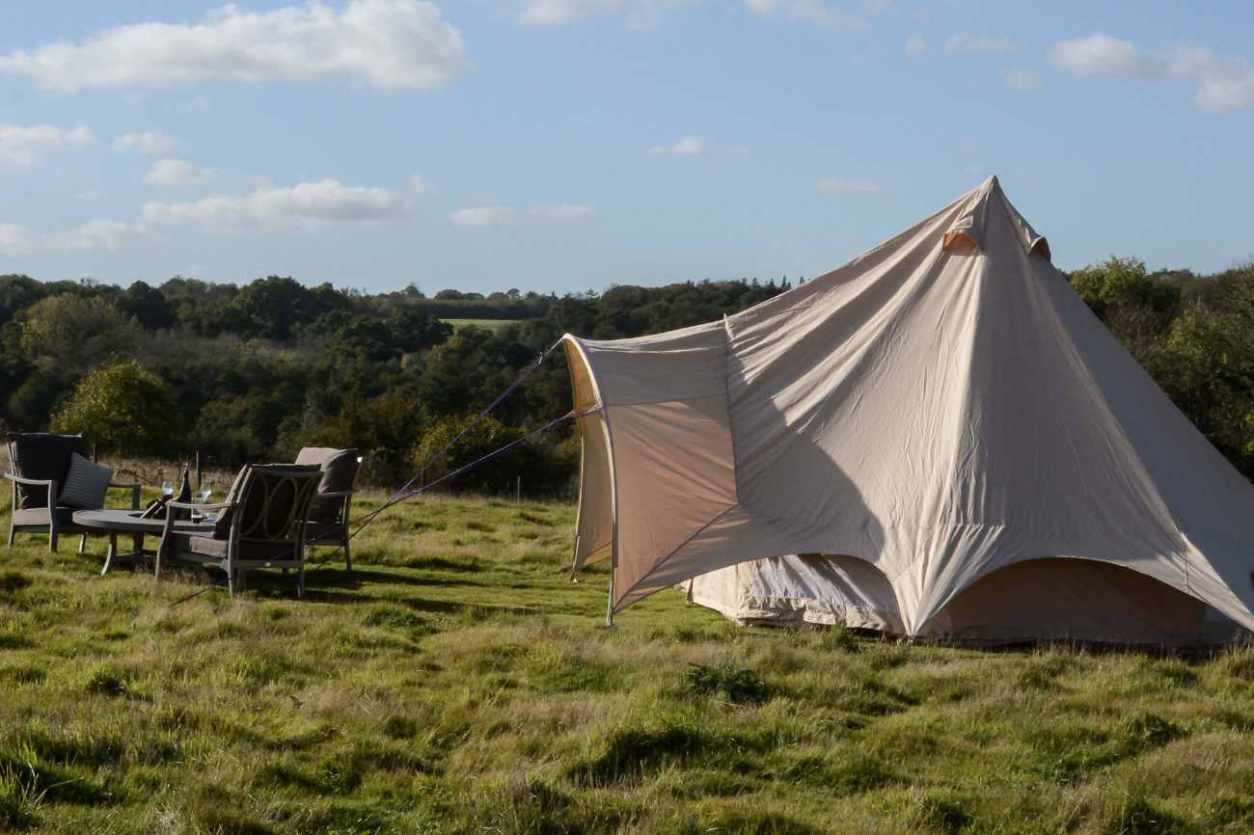white-chegworth-mill-glamping-tent-in-field