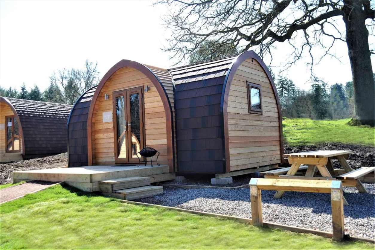 whitemead-forest-park-glamping-pods-with-outdoor-seating