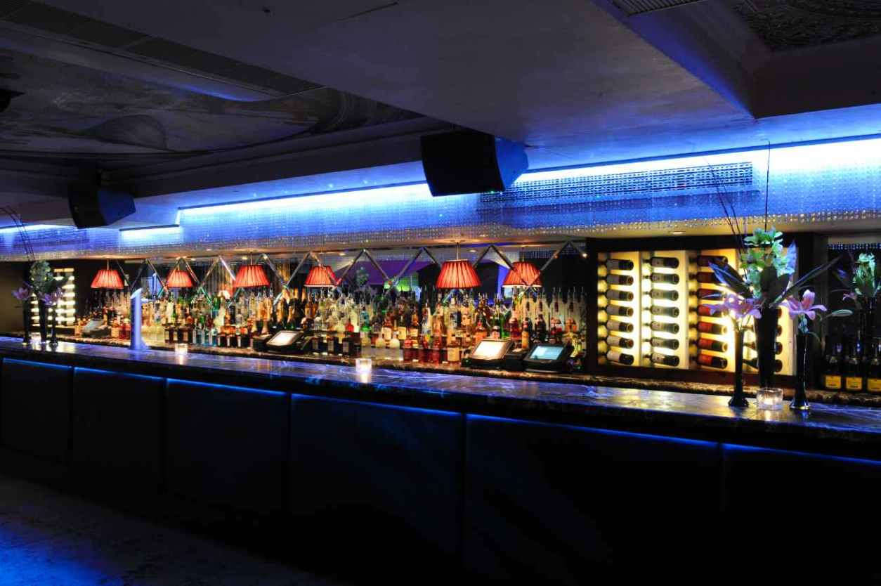 bar-lit-up-in-colours-at-night-at-ruby-blue