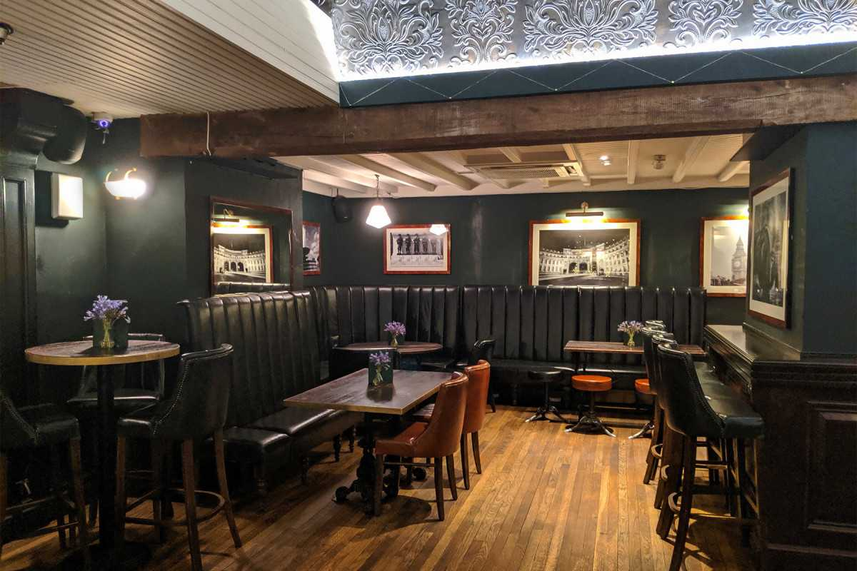 bar-seating-and-restaurant-tables-inside-walkers-of-whitehall