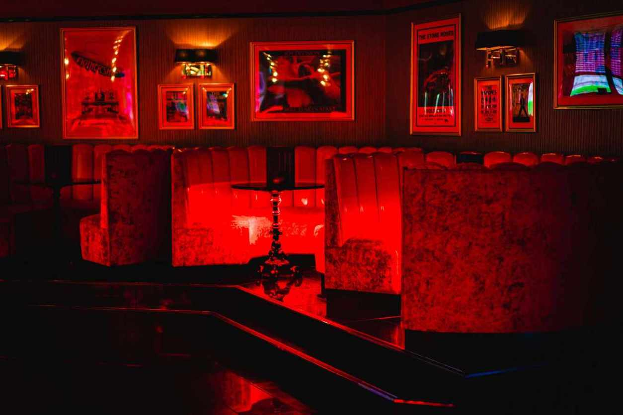 booths-inside-kuckoo-bar-lit-up-red-at-night