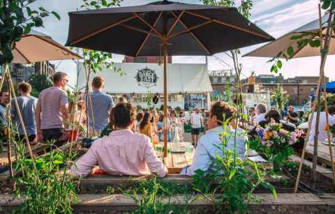 people-drinking-at-barge-east-bottomless-brunch-east-london