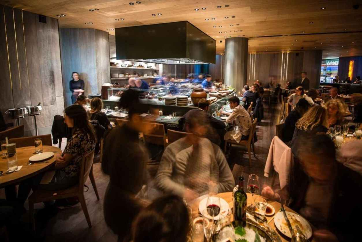 people-eating-by-kitchen-at-roka-restaurant-aldwych