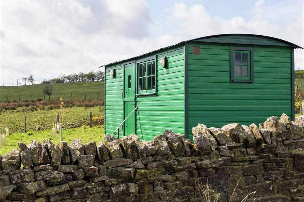 exterior-of-green-peat-gate-shepherds-hut-in-field