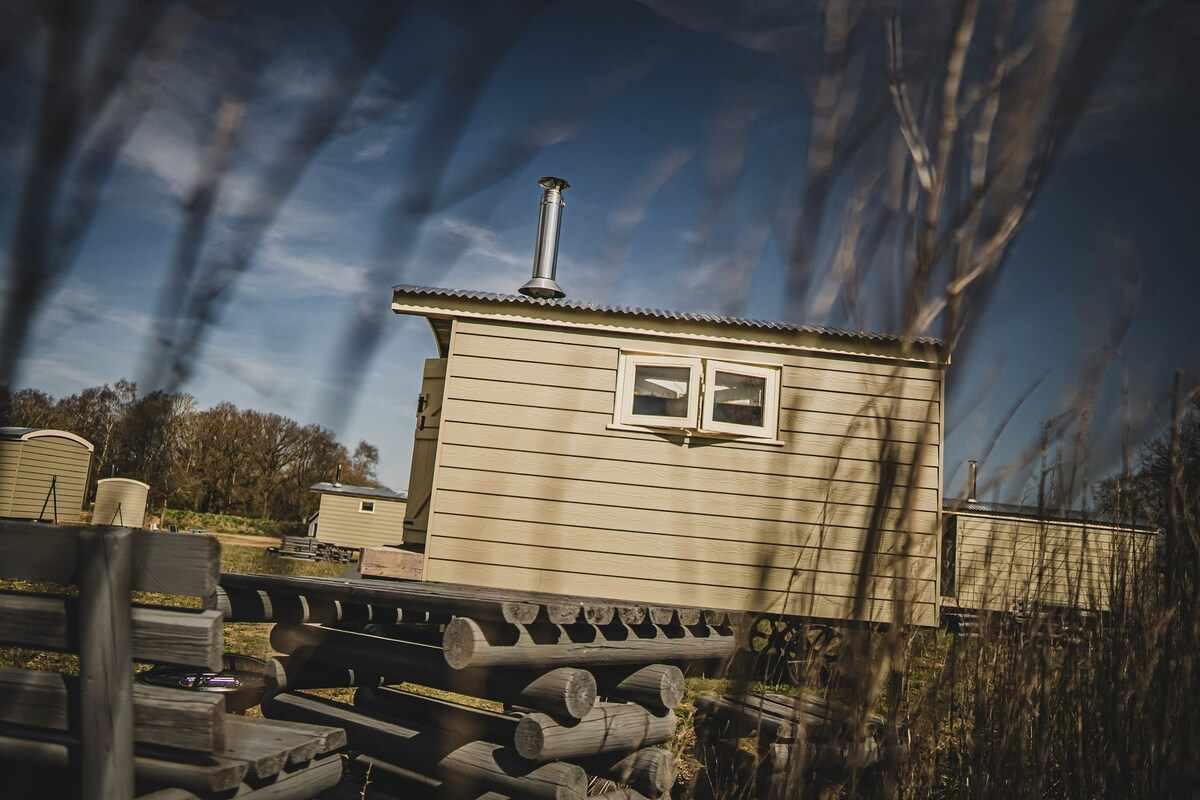 exterior-of-range-farm-orchid-shepherds-hut-in-field