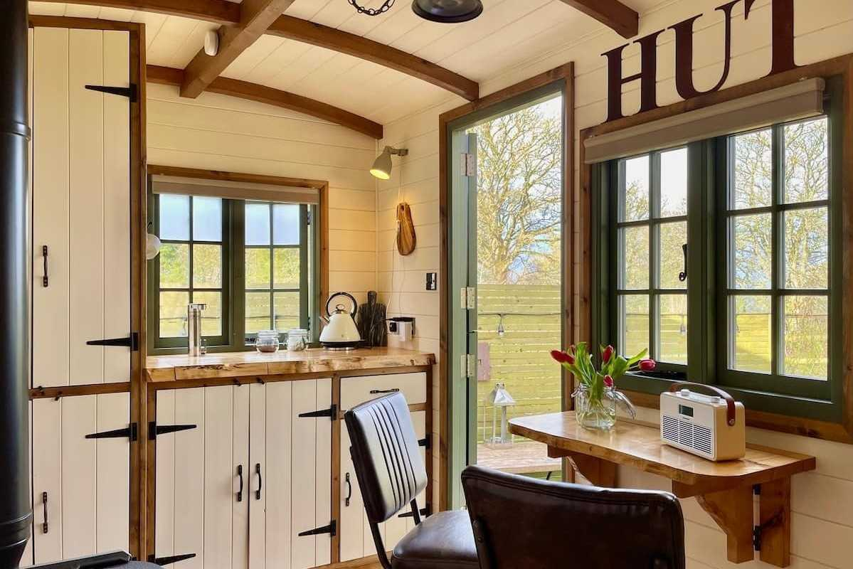 interior-of-manor-house-hut-with-table-and-kitchenette
