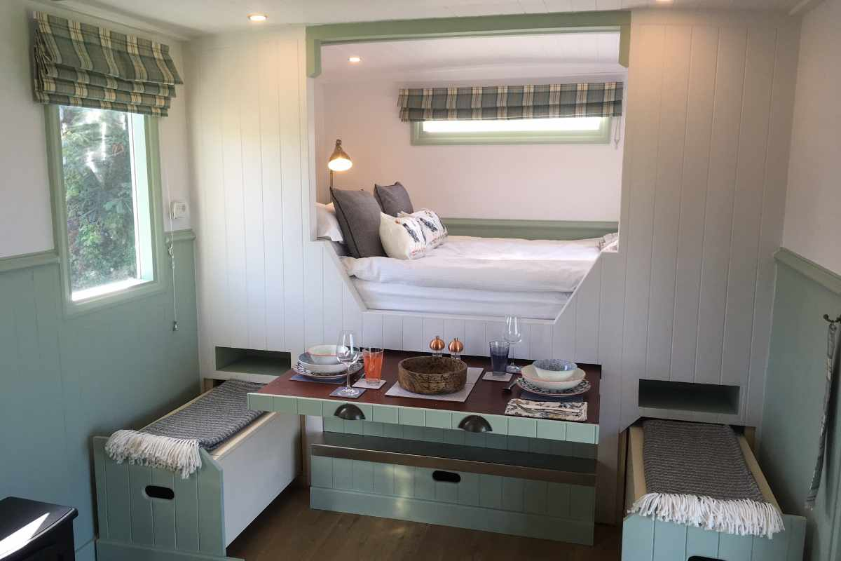 interior-of-shearling-shepherds-hut-with-table-and-bed