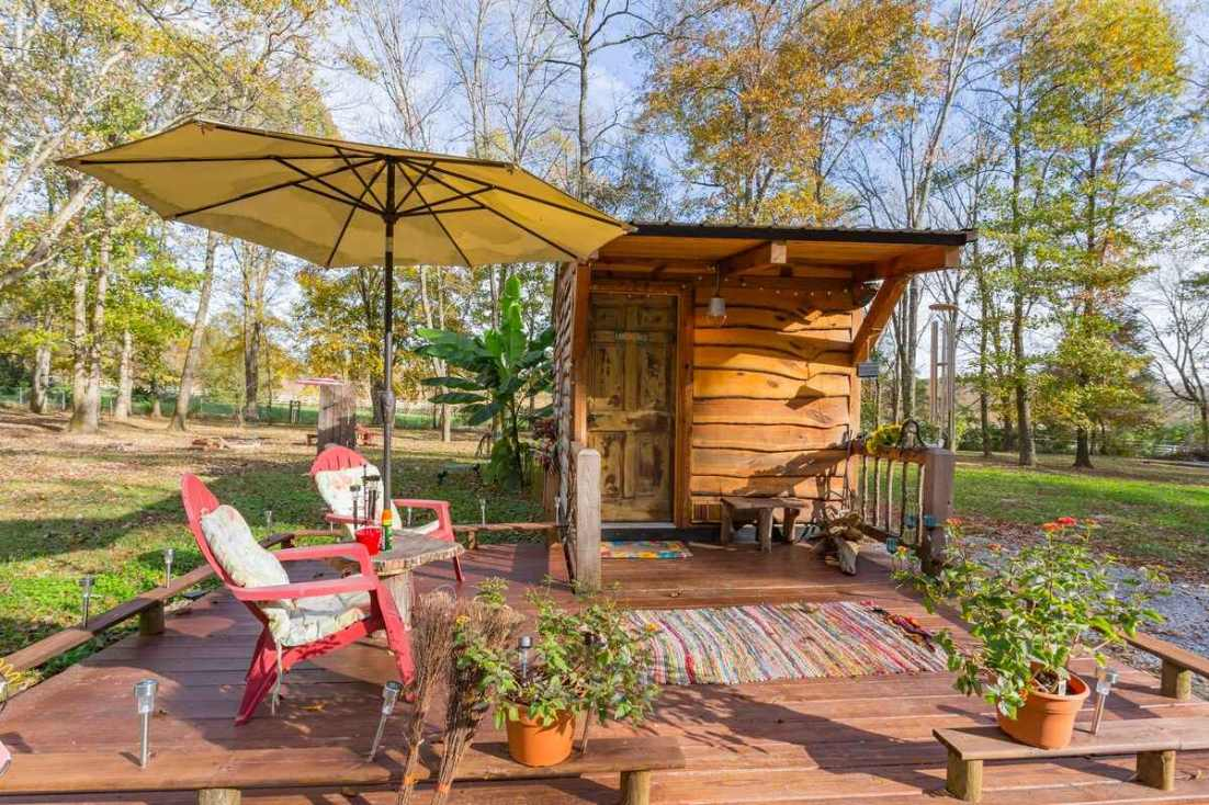 limerence-tiny-house-with-decking-in-woodland