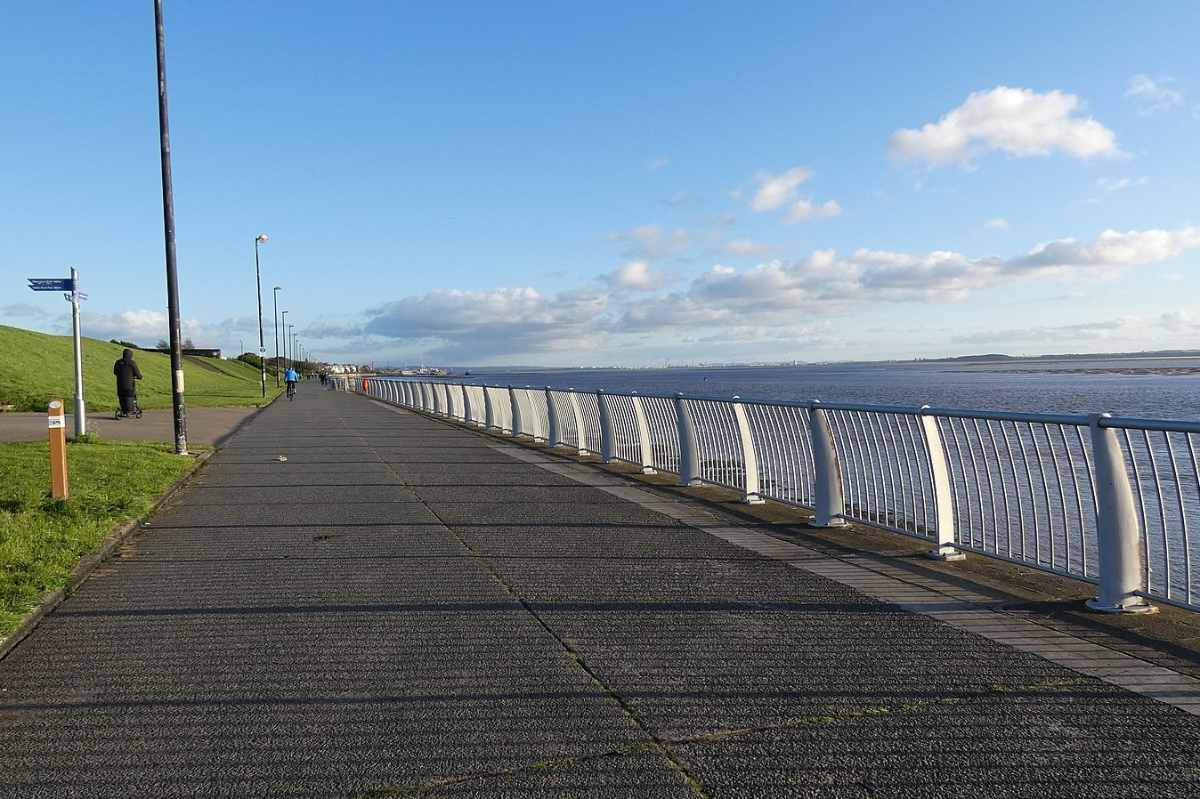 otterspool-promenade-by-water-on-sunny-day