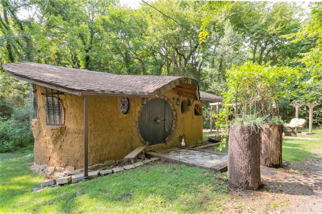 the-hobbit-house-in-field-in-daytime