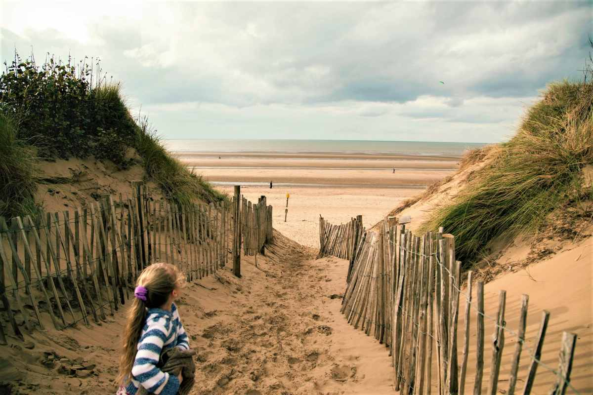 young-girl-walking-towards-formby-beach-beaches-in-liverpool