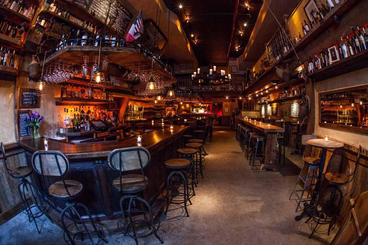 bar-and-tables-inside-dark-carroll-place-restaurant