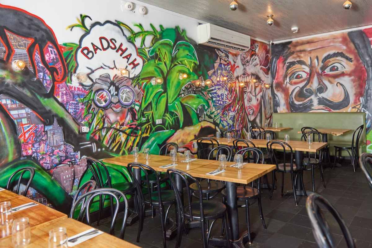 graffiti-on-walls-of-badshah-restaurant-by-tables